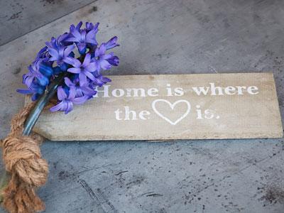 Fußmatte mit lilafarbener Blume