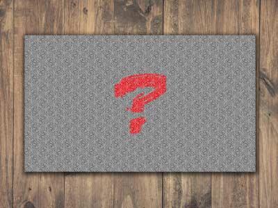 Fußmatte mit rotem Fragezeichen